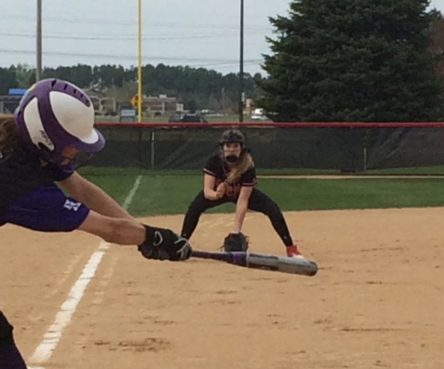 "Third baseman Alex Ehde gets in position as she anticipates the ball coming to her during the game against Cretin-Derham Hall. ""My hopes for the team this year is to have a good conference record and to hopefully make it to state! I think we are more committed this year. Every game and practice matters and I believe my teammates feel the same and work hard. As long as we play for each other and communicate we can go far,"" says sophomore Alex Ehde."