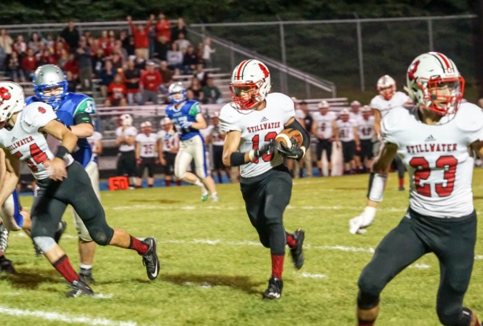 Murr carries the ball down the field with speed. This is his second year playing cornerback on the varsity football team.