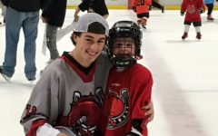 Murr smiles at the camera after coaching what seems to be Stillwaters future hockey players. Purrs great leadership skills help make him a great coach.