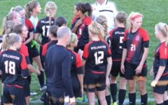 Girls soccer team rushes out of gates