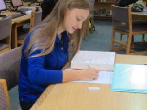 National Merit Scholarship semifinalist, Marta Markowitz doing her homework in the media center.