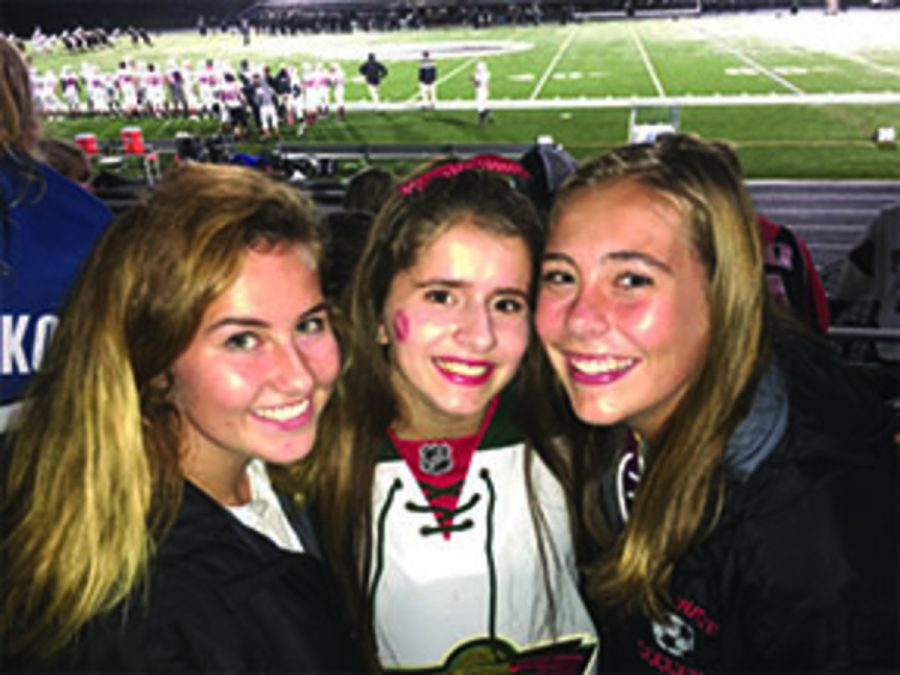 Juniors Danielle Keran, Michelle Strodthoff and Ellen Lenertz getting ready to watch a great football game. Strodthoff says,