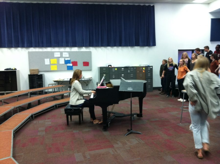 The bell has rung, and Mrs. Mitchell begins taking the students through Warm-ups, to prepare everyone's voice for a rehearsals worth of singing. She has her own style of running the choir through warm-ups, usually including some variation of a scale or pattern to both prepare students' voices and their minds to learn. Her reason for warm-ups is not only to prepare, but