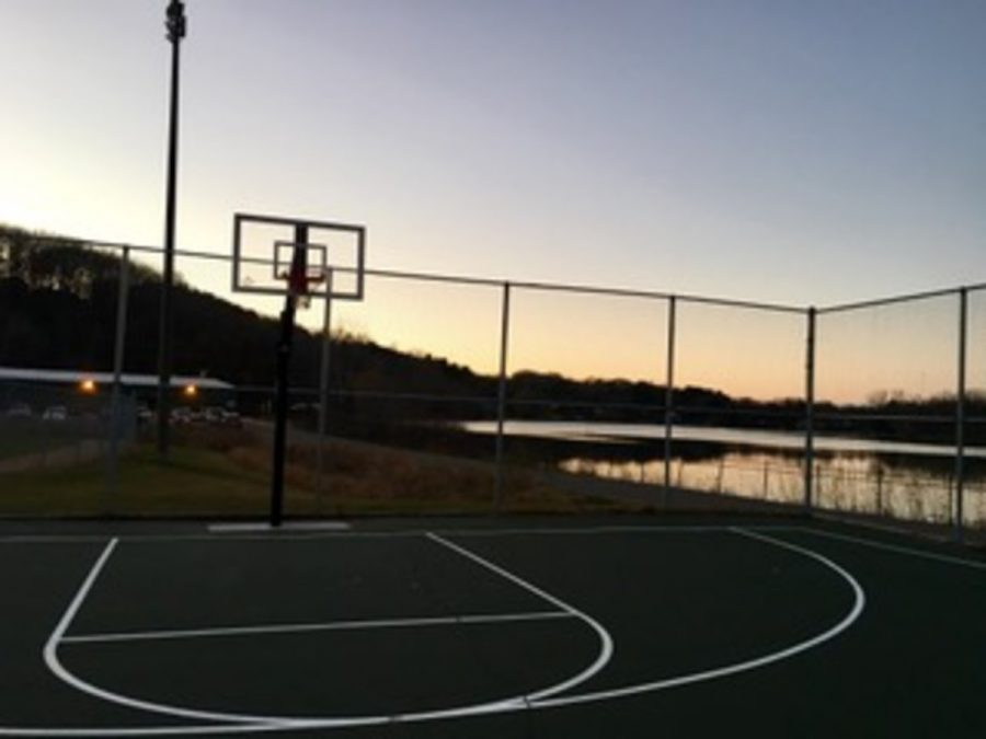 Photo by Bella Anderson- The basketball court with the lake and sunset in the background at Lily Lake. On himself before the injury Lucas says,
