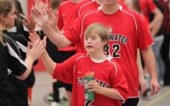 John Lindeberg #2, is seen here giving high fives after finishing an intense game. John loves playing on the Stillwater adaptive soccer team and representing the Stillwater Ponies.