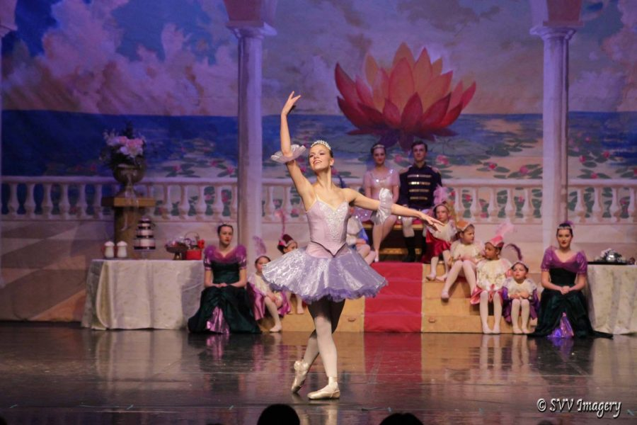 Senior Mckenzie Brady dances as the sugar plum fairy on stage. The sugar plum fairy seems to come out of nowhere to dance in the spotlight in the last few moments of the ballet and is a favorite among ballerinas.