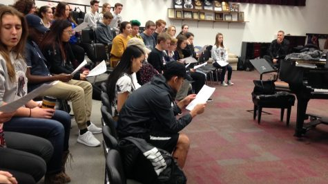 While students rehearse for auditions, Grif Sadow watches the talent of the musicians.