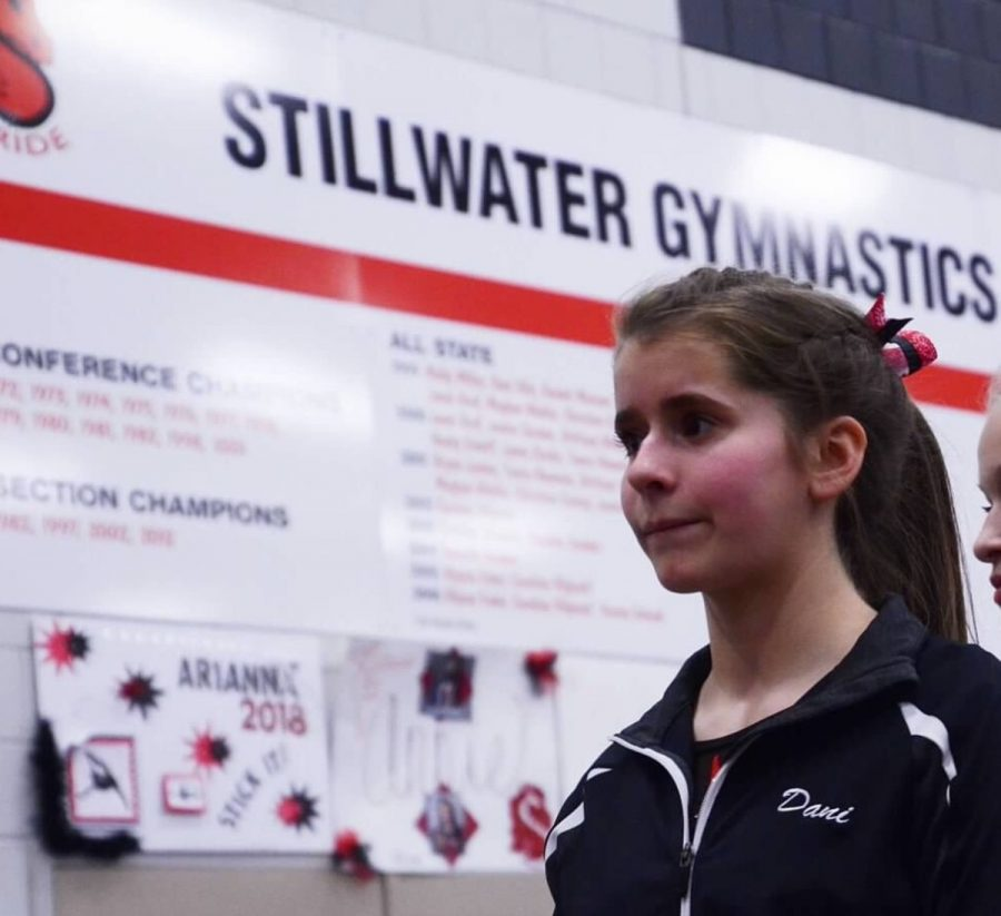 """Junior captain Danielle Keran before the meet in her warm ups. Keran says, """"We were all together as a team getting ready to go, we were a little nervous because it was the first one, but we were also excited."""""""