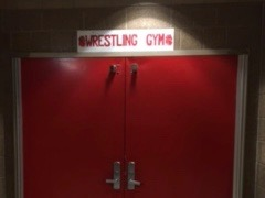 "This is the entrance to the wrestling gym. Jared Christian says, ""There's always something to work on."""
