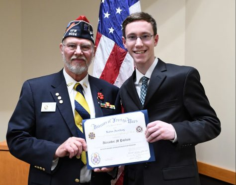 This is a photo of Alexander Pavlicin accepting the first place award in the Woodbury VFW Voice of Democracy Scholarship Program.  Pavlicin says,