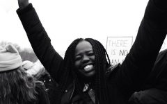 Junior Bakange Ajak smiles while marching at the Women's March in St. Paul on Jan. 21.