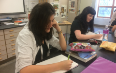 """Senior Andrea Gomez Molano working on a piece for her portfolio. """"I want people to realize that my country and my home is so much more than just war and drug trafficking, it is really important for me to show that in every one of my pieces,"""" Gomez Molano says."""