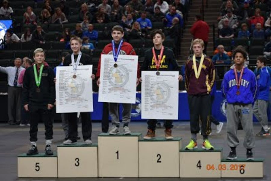 Reid+Ballantyne%2C+in+8th+grade%2C+wins+individual+state+for+the+106+weight+class.+%22We+have+really+good+individuals+%28wrestlers%29+like+Reid+Ballantyne+who+was+a+State+Champion%2C%22+senior+Captain+James+Huntley+comments.