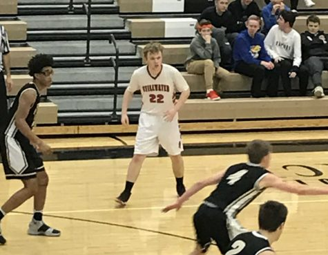 "Corcoran (number 22) in his last game high school game against East Ridge. ""I've missed out on other opportunities, but I think it was worth it,"" he says."