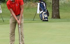 Anderson focuses as he takes a put. Competition is valued on the golf team and Anderson adds to that spirit.