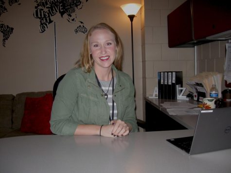 Koenen smiles behind her desk, welcoming students to come and meet her.