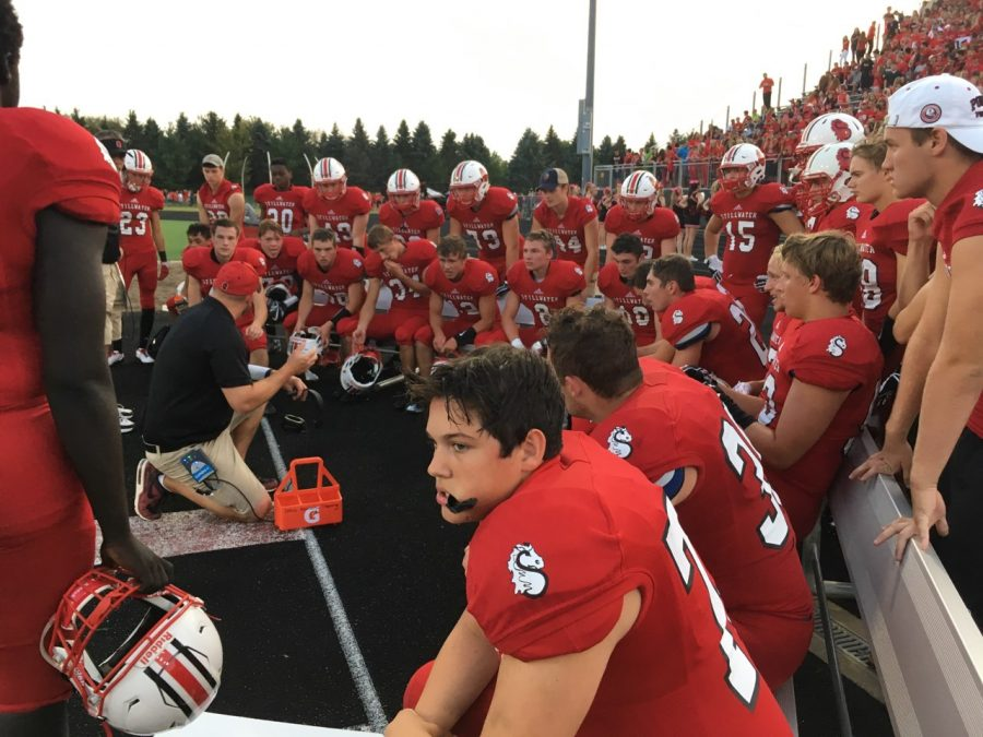 "The Ponies football team huddles during the homecoming game. ""We all stand as one school,"" Megan Ramberg says."