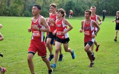 """Coach Scott Christensen supports his team in any way possible. """"I love Scott, ever since day one he's just been a cool, down to earth guy. He makes the Cross Country atmosphere so funny and lighthearted, and he takes the time to get to know you.""""Senior Riley Call says."""
