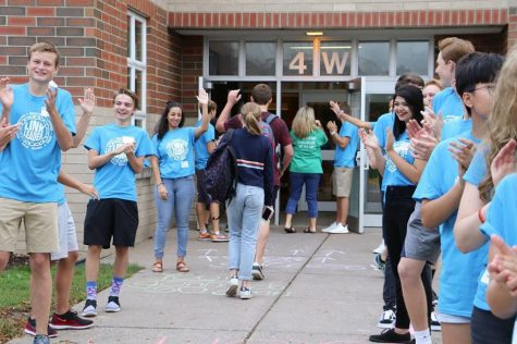 Senior and junior Link Crew leaders welcome freshmen students to the building on the first day of school.