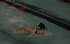 Eighth grader Estelle Auleciems  swimming the butterfly during Thursday's meet against East Ridge.