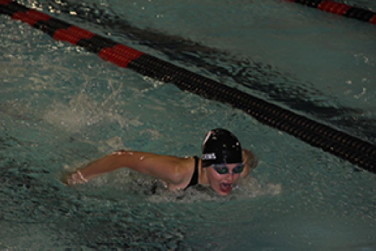 Girls swim team battles chlorine