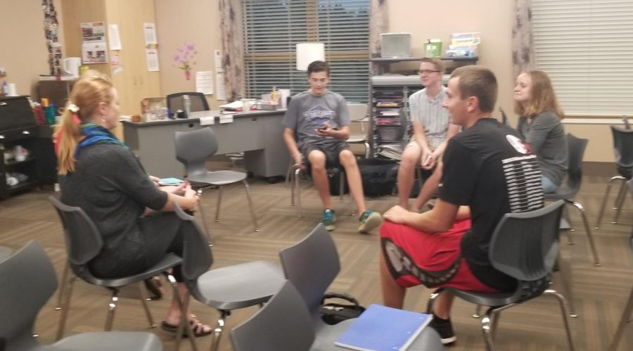 SNHS Students talking about the blood drive and other related events.