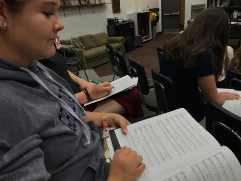 Sophomore Josie Haugen reading her music during choir in preparation for the retreat.
