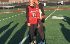 Madison Horn and Haley Nelson need to take a quick photo before getting ready for warm-ups for the Powder Puff game
