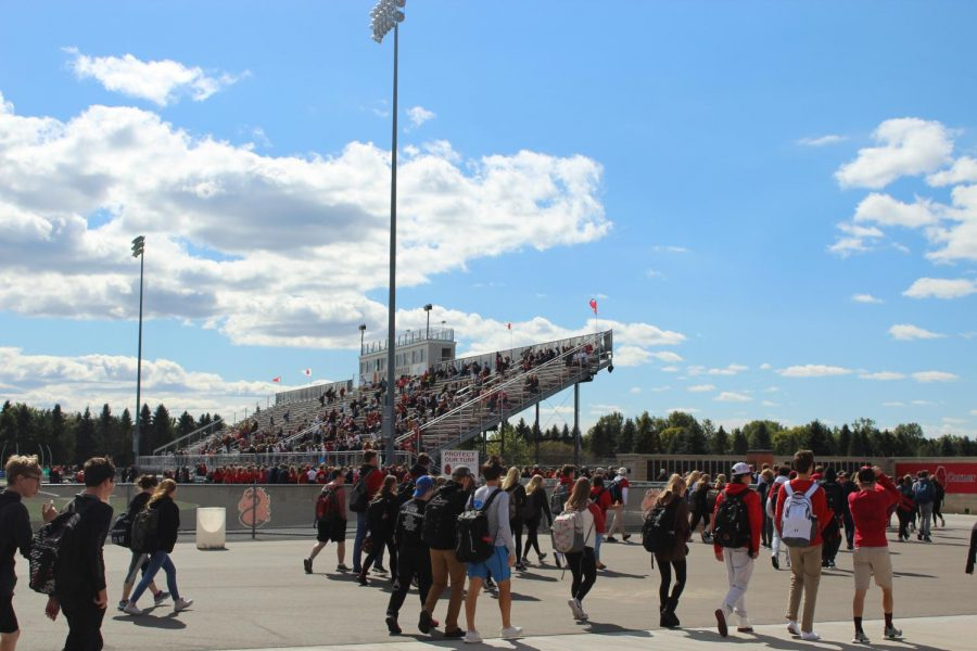 Students file into the bleachers for the annual Homecoming pep fest Sept. 28.