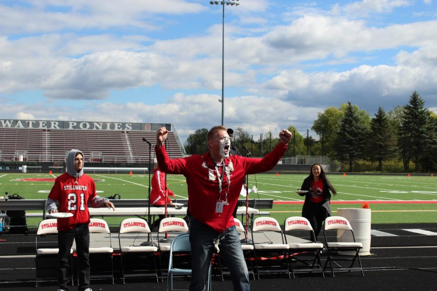 After getting pie-d by a student, Principal Bach led students in the Fight Song.
