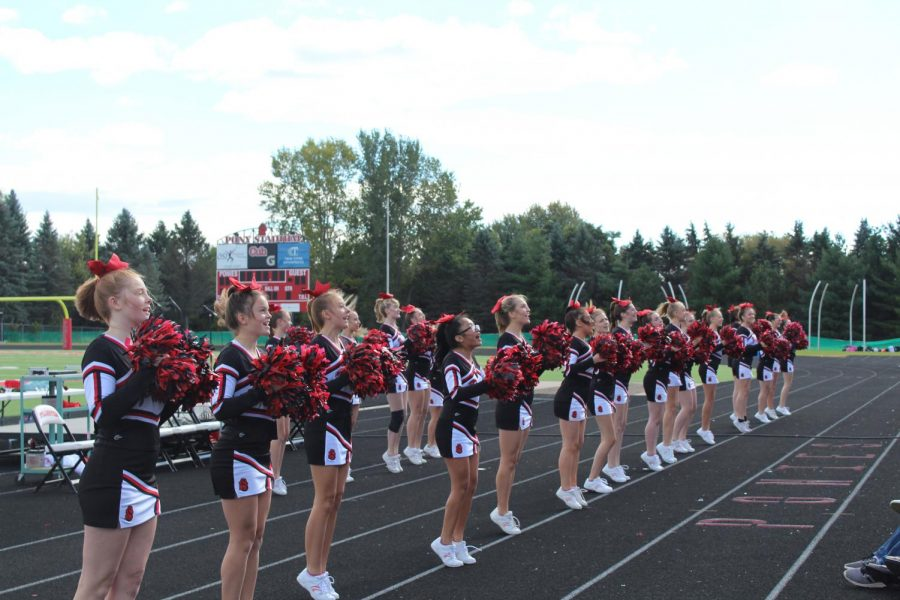 The Cheerleaders teach students new cheers for the upcoming Homecoming game.