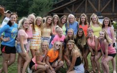 Young Life girls having fun at Castaway camp during the nineties night.