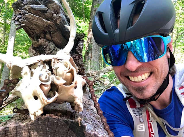 Assistant Principal Aaron Drevlow was biking at Brown County Mountain Bike Park in Indiana when he noticed an animal skull on a tree branch and took a selfie!