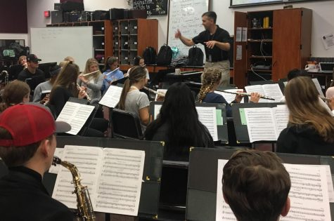 Band teacher Joel Bryan conducts rehearsal for the Kaleidoscope concert.