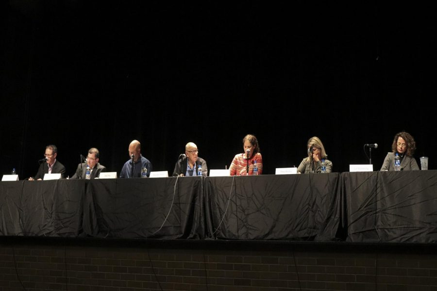 Running school board candidates Mark Burns, Matthew Cooper, Jon Fila, Don Hovland, Shelley Pearson, Tina Riehle, and Liz Weisberg speak at a panel. They are campaigning for the four school board seats opening on December 31st, 2018.