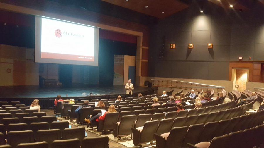 Principal Rob Bach and community members meet in school auditorium for a discussion regarding student vape use.