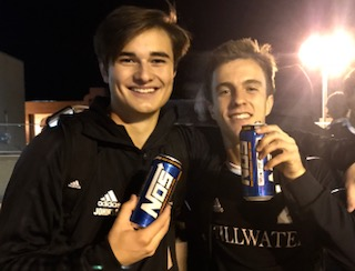 After playing in the boys soccer quarterfinal game on Oct. 25, senior Rayce Johnson and junior Nick Purdie finish off the game and celebrate their win with a Nos energy drink.