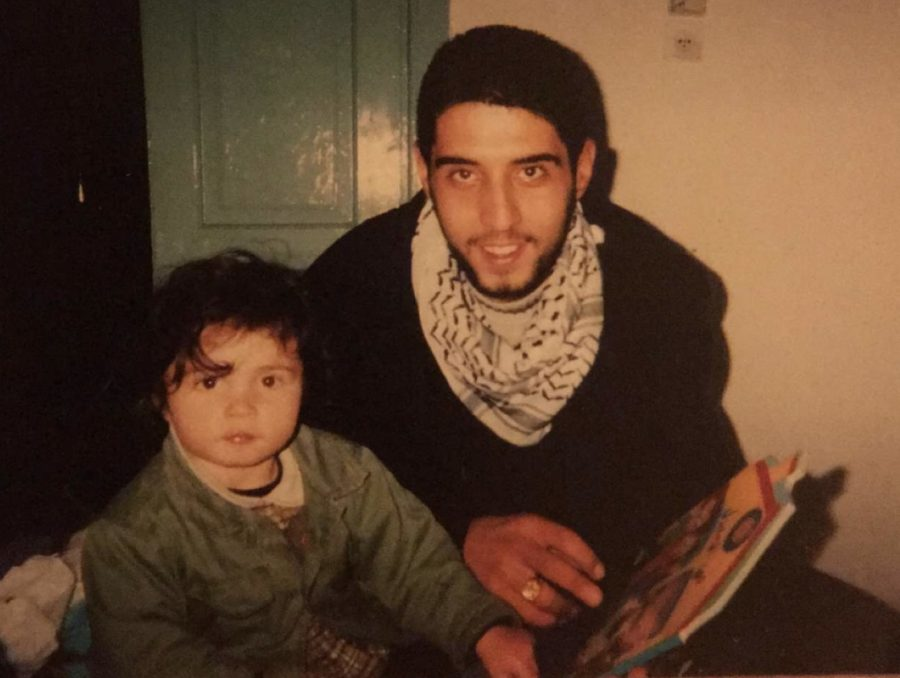Tessa Johansens's father, Tarek Abu Bassam Abu Sbeih, reads to her from a children's book. Johansen is back to visit him after moving to the United States with her mother, Gina Johansen.
