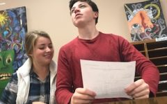 After school on Oct. 22, team members practice for their upcoming tournament at Minnehaha Academy. In the flex room, juniors Henry Still and Madi Kulzer rehearse their opinions on the new topic. Debaters will argue if Amazon is positively or negatively affecting America.