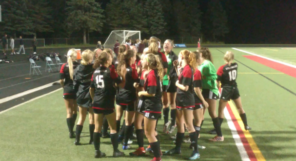 Girls varsity soccer team huddles before winning game played at home VS Roseville. The team ended regular season with 18 wins, 1 loss, and 4 ties.
