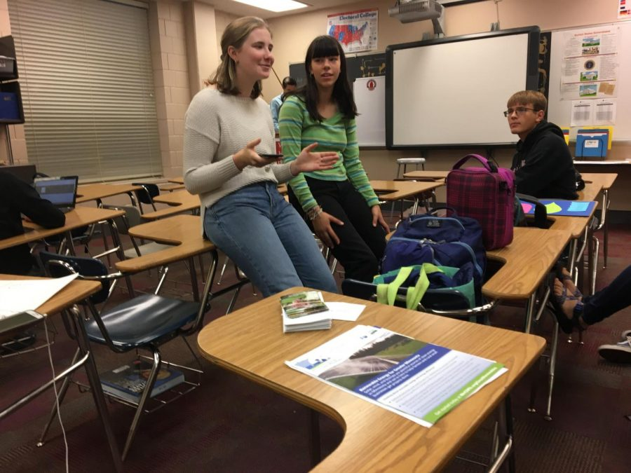 Student leaders Bijou Acers and Emma Bourne, both sophomores, lead a YFSS meeting during the morning of Oct. 9. They discuss the use of solar power in the school district.