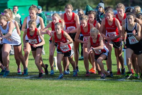 The varsity girls cross country team starts off strong at their conference meet. Sophomore Ana Weaver (in red, farthest to the left) starts off on the right foot at the girls conference meet.