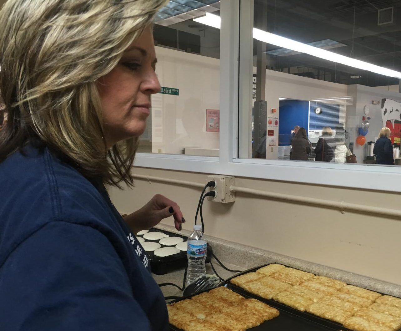 ASL teacher Amy Caslow flips hash browns at Metro Deaf School on Nov. 10. She, along with many of her students, were volunteering at the Pancake Breakfast fundraiser.