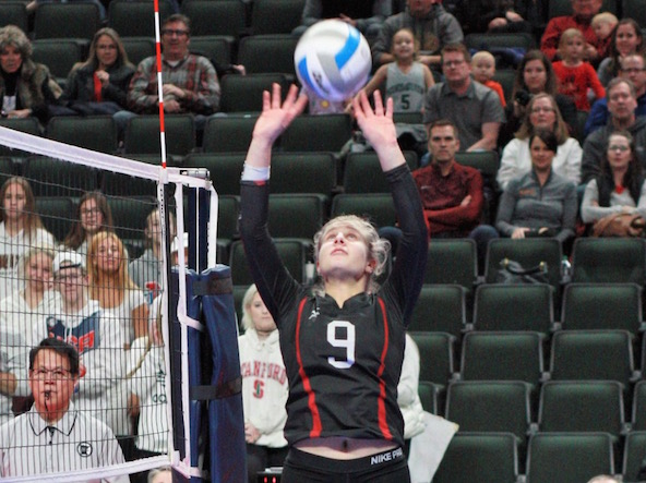 Senior Olivia Walsh sets during a volleyball game at the Xcel Energy center on Nov. 8. It is the final game during State against Lakeville South.