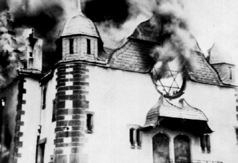 A German synagogue left to burn, no firefighters will come. Nov. 1938, similar attacks are being carried out across Germany on the night known as Kristallnacht. Last October the shooting of a synagogue in Pittsburgh shows that antisemitism is still present despite the defeat of Nazi Germany.