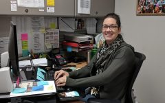Rahel Anselmo works at her desk by planning Principal Bach's day and coordinating with students and staff. Anselmo has been working in her current position for almost 5 years, and loves what she does.