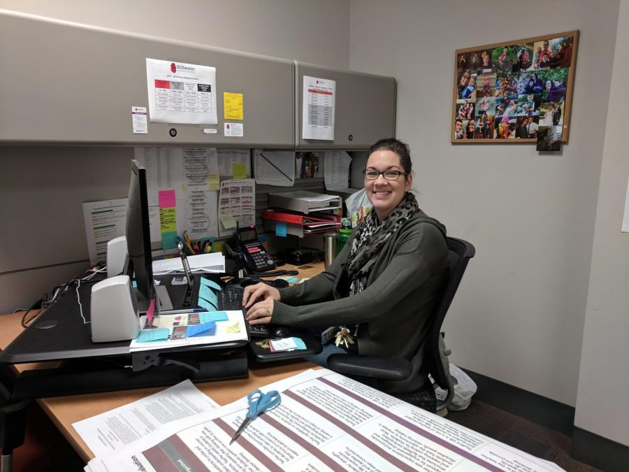 Rachel Anselmo working at her desk by serving the Stillwater Area high school students and staff. Mrs. Anselmo has been working in her current position for almost 5 years, and loves what she does.