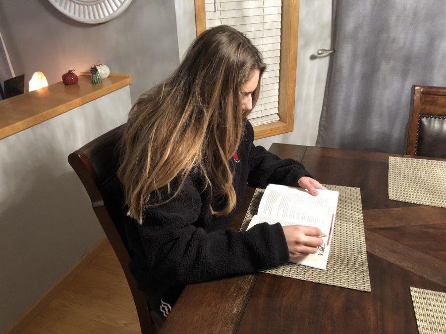 Freshman Adrianna Garcia reads