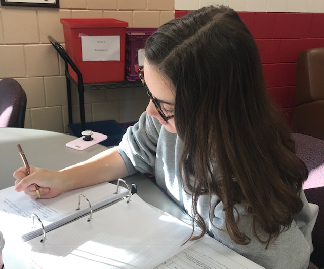 Senior Hannah Sween works on her newspaper assignment. Sween is an Editor-in-Chief for the newspaper this school year. During class, Sween works on her assignments and also answers the field reporters' questions. The work she puts into this class is directly correlated to her accomplishments.
