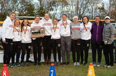 Members of the Ponies girls cross country team celebrated their conference championship with Coach Podolske. The Ponies would go to capture fifth place at the State meet.